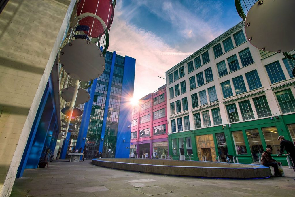 Birmingham's Custard Factory at sunset showing its bright coloured buildings