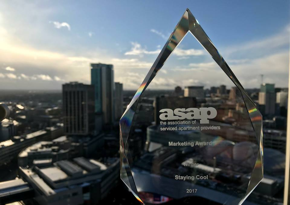 Association of Serviced Apartment Providers award made of glass with view of Birmingham behind