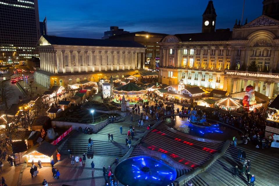 Birmingham Christmas market from above showing Victoria Square lit up at night