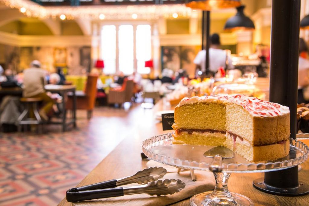Edwardian Tea Rooms at Birmingham Museum and Art Gallery with sponge cake on display