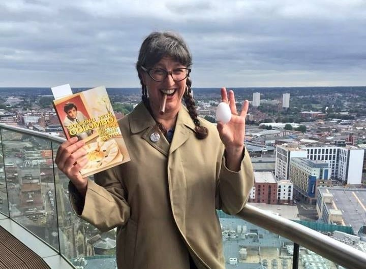 Jenny Hammerton of Silver Screen Suppers on the balcony of one of our penthouses in Birmingham holding her Cooking With Columbo book
